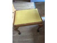 Dressing table stool , wooden legs . Queen arm shaped legs . Size L 20in D 15in H 18in.