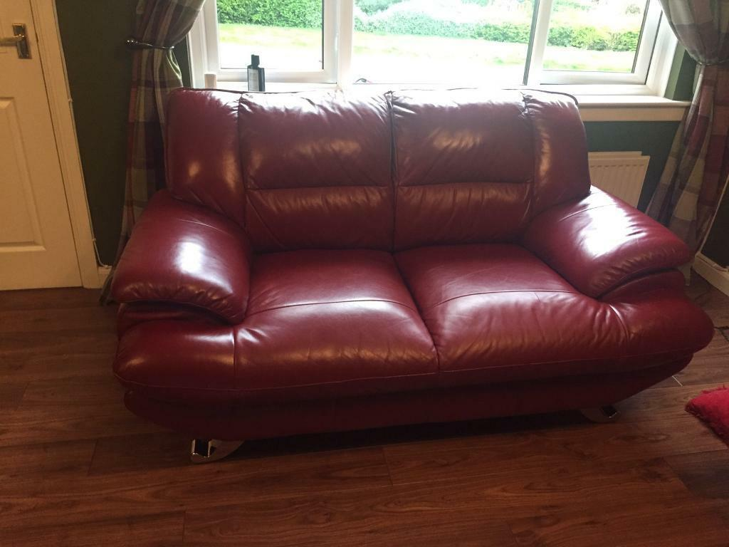 Red/wine leather 3 and 2 seaterpouffeein Danderhall, EdinburghGumtree - Selling my settees and footstool. These settees are really really comfy. Good condition. Couple wee scratches but not really noticeable . The 2 seater has a scratch on the right seat which I have shown in pics, but doesnt really take anything away...