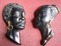 A VINTAGE PAIR OF RETRO AFRICAN CERAMIC WALL PLAQUES
