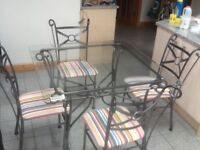 Glass dining table & 4 chairs-table and chair frames are metal ,tightened&sturdy,excellent condition