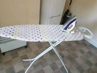 Ironing board and iron for sale .