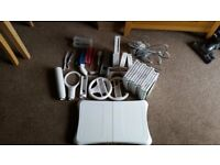 Nintendo Wii with 12 games + accessories and Wii Balance Board