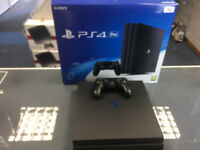 1TB Playstation 4, Black Slim w/ Cables & Controllers