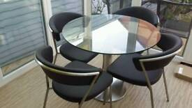 Round Glass Dining Table and Chairs