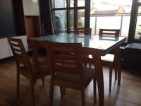 Free Delivery Calligaris dining table and four Chairs