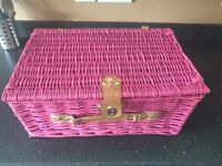 Picnic basket with picnicware inside