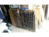 Black Wrought Iron Gate with Hanging Hooks