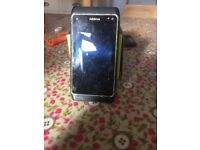 Mobile phone, needs charging and a SIM card, works fine