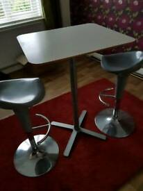 Table and two bar stools