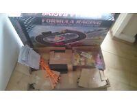 New in box Formula Racing battery operated road racing set