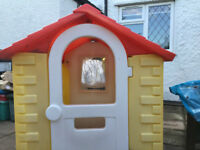 A large outdoor plastic playhouse - for hours of fun!