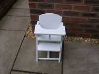 A wooden doll's high chair.