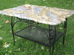 Indoor/outdoor natural stone topped end table.