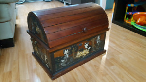 Wood chest with cata ornaments