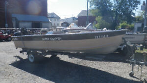 ..several used boats with outboard engines and trailers...