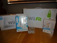 Nintendo Wii with Wii fit, charge station & Games