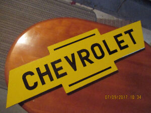 SMALL CHEVROLET SIGN.
