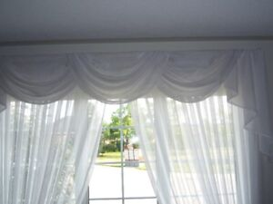 White semi-sheer drapery and valance with rod