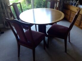 Extending dining table with four dining chairs