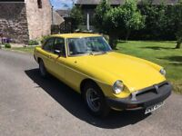 Low mileage professionally reconditioned yellow MGB GT.