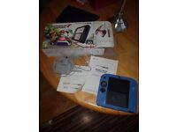 Boxed like new 2ds with mario and game