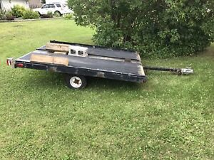 Tilt deck sled trailer