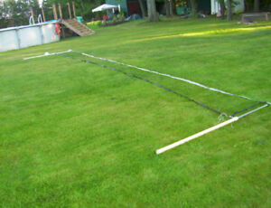 volley ball net and poles complete in box