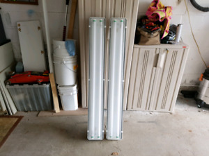 (2) 48 inch water resistant and dust proof light fixtures