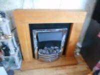 oak surround fire place and electric fire