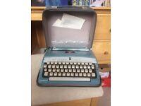 Vintage Brother Deluxe Typewriter in Powder Blue circa 1960s w/ original manual