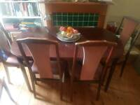 Extendable dining room table and 5 chairs