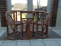 Wicker table and 2 chairs hardly been used good clean condition