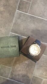 Authentic Michael kors navy and gold watch. Only worn once comes with box