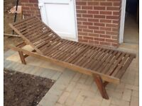 Wooden garden lounger for the garden