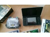 Nintendo DS with Guitar Hero and 4 games and Case and Charger