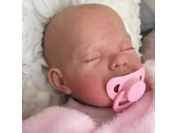 Stunning reborn doll with 50+ accessories inc clothes, toys, blankets and dummy.