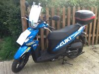 Suzuki Address in MotoGP colour very low mileage, top box and screen. Mint condition and ready to go