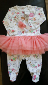 Girl's 6-9 month oneies with tags