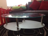 Oval clear glass coffee table on sale