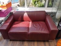 small red sofa few scratches on arms