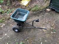 Tow behind seed spreader