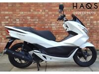 Honda PCX 125 with 1500 miles only