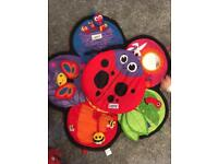 Lamaze Tummy Time toy with spinning tummy support