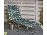 Sun lounger with leafy print