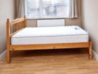 wooden double bed frame for sale with nearly new mattress