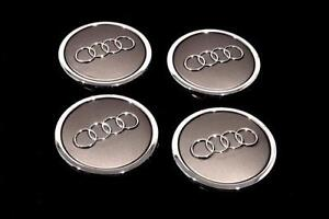 BRAND NEW NEVER USED. AUDI CENTER CAP SET OF FOUR.