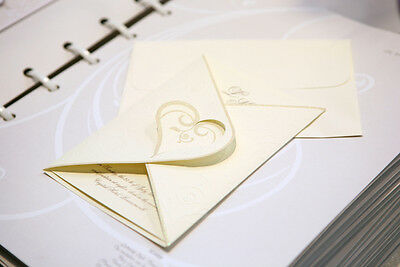 Traditional cream and gold printed wedding invitation.