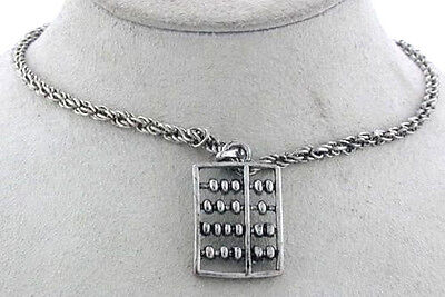 SILVER TONE NECKLACE WITH ABACUS CHARM
