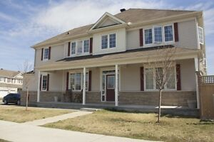 End Unit Townhome with Double Garage in TrailWest Kanata