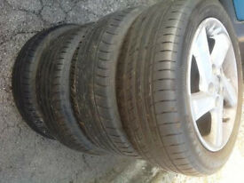 Full set of Mazda 6 alloys with part used tyres 205/65 R16